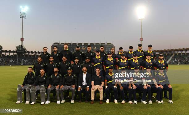 The MCC and Lahore Qalanders teams and officials pose for a photograph before the T20 match between MCC and Lahore Qalandars at Gaddafi stadium on...