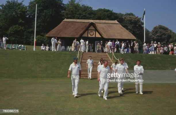 The MCC team take to the field before a charity match against Sir Paul Getty's XI at Getty's new cricket ground on his Wormsley Park estate in...