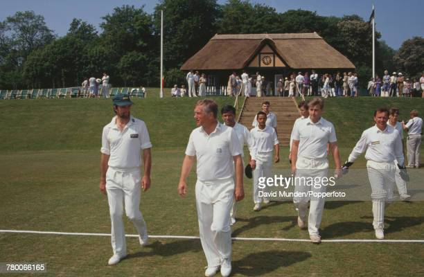 The MCC team take to the field before a match against Sir Paul Getty's XI at Getty's new cricket ground on his Wormsley Park estate in...