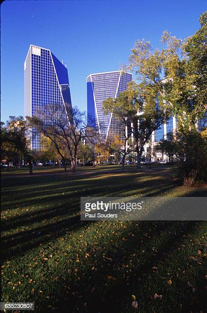 The McCallum Hill Centre's twin towers rise above trees displaying fall foliage in downtown Regina, Saskatchewan, Canada.