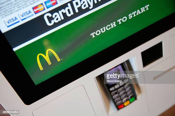 The McDonald's Corp logo sits on a touch screen card payment panel inside a McDonald's Corp restaurant in Manchester UK on Monday Aug 10 2015...