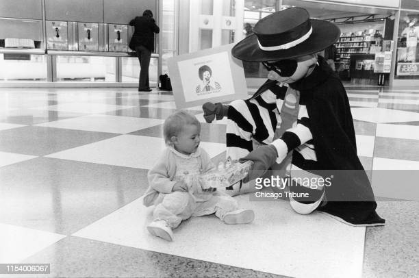 The McDonald's Hamburglar hands a children's Happy Meal to 1yearold Cameron Rose Conlon in the United Airlines terminal at O'Hare International...