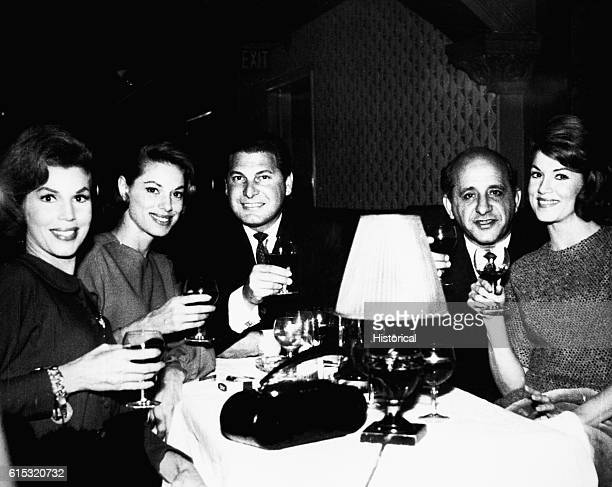 The McGuire Sisters Christine Dorothy and Phyllis are joined at a London nightclub by hairdresser Frederic Jones and Salvatore Giancana following a...