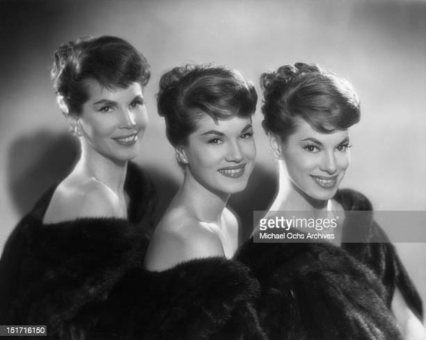 The McGuire Sisters LR Christine Phyllis and Dorothy pose for a portrait circa 1958 in New York City New York