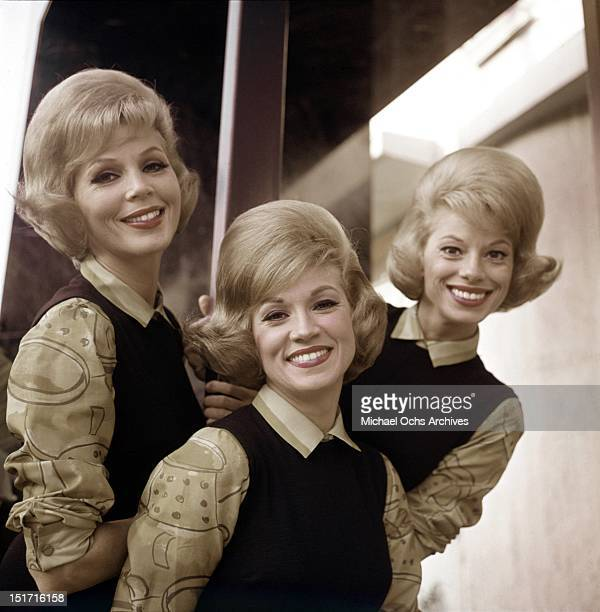 The McGuire Sisters LR Christine Phyllis and Dorothy pose for a portrait circa 1960 in New York City New York