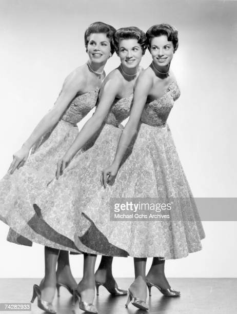 The McGuire Sisters LR Christine Phyllis and Dorothy pose for a portrait circa 1950 in New York City New York