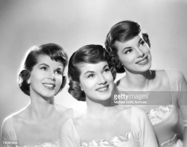 The McGuire Sisters LR Christine Phyllis and Dorothy pose for a portrait circa 1957 in New York City New York