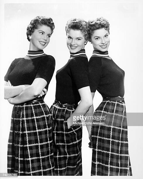 The McGuire Sisters LR Christine Phyllis and Dorothy pose for a portrait circa 1955 in New York City New York