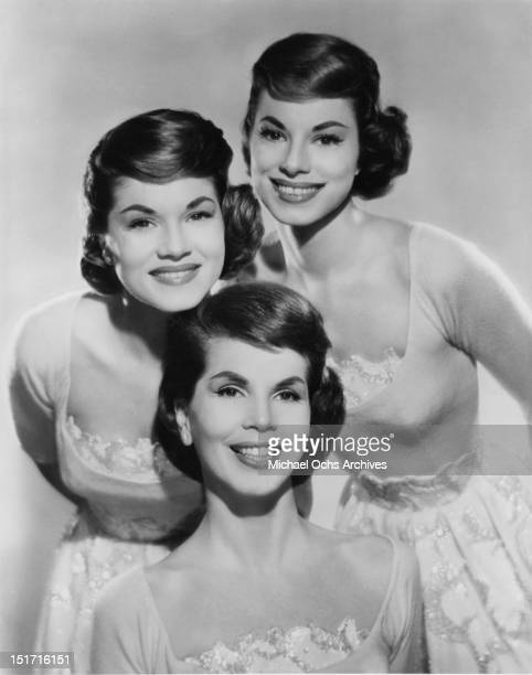 The McGuire Sisters LR Phyllis and Dorothy and Christine pose for a portrait circa 1957 in New York City New York