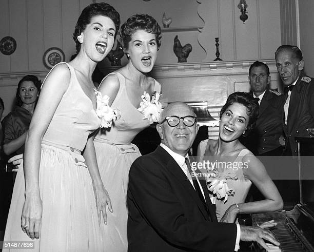 The McGuire Sisters singing with songwriter Jimmy McHugh at the piano Undated photo