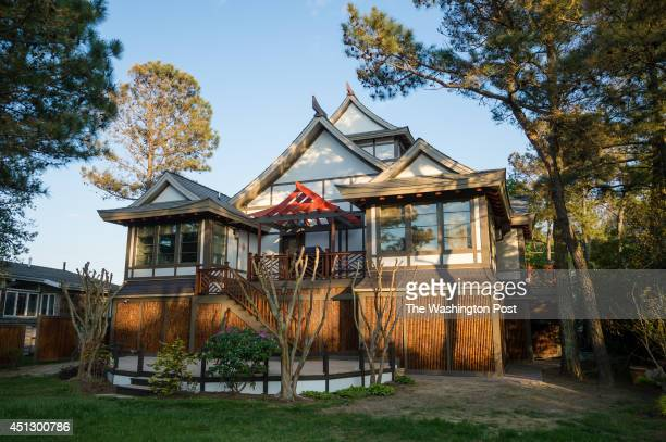 The McIntire's Japanese inspired beach house in Rehoboth Beach DE incorporates an asianthemed pergola on the elevated back deck