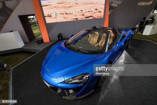 The McLaren 570S Spider automobile sits on a stand during its unveiling at the Goodwood Festival of Speed in Chichester UK on Thursday June 29 2017...