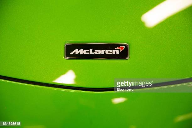 The McLaren Automotive Ltd logo sits a 570S automobile during a news conference announcing the company's building of a plant in Sheffield UK on...