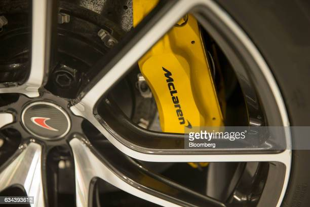 The McLaren Automotive Ltd logo sits on a brake of a 570S automobile during a news conference announcing the company's building of a plant in...