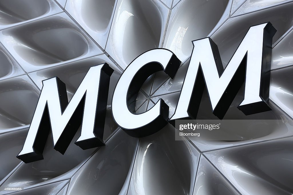 The MCM Holdings AG logo is displayed at the company's store on Garosugil street in the Gangnam district of Seoul, South Korea, on Sunday, Dec. 22, 2013. Consumer prices climbed 0.9 percent in November from a year earlier after a 0.7 percent increase in October that was the smallest gain since July 1999. Photographer: SeongJoon Cho/Bloomberg via Getty Images