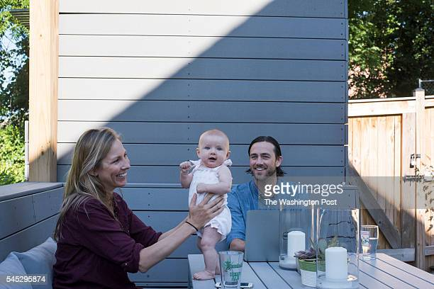 The McNeal's enjoying an afternoon on their backyard deck on June 29 2016 in Washington DC from left to right Anne McNeal Estelle McNeal 3 months old...