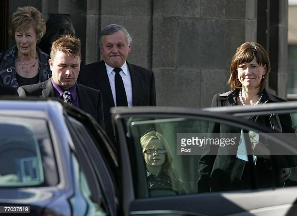 The McRae family including wife Alison McRae and father Jimmy McRae leave the funeral of Colin McRae and son Johnny at East Chapel, Daldowie...