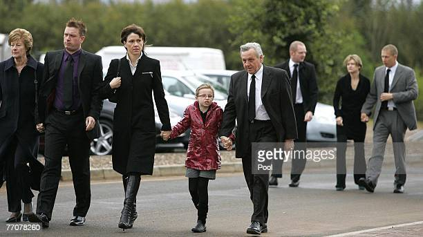 The McRae family Margaret Stuart Alison daughter Hollie with Jimmy followed by Alister McRae arrive at the funeral of former quad bike champion...