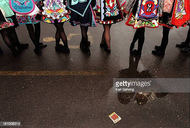The McTeggart Irish Dancers lined up in a wet parking lot Saturday morning waiting to kick off the annual St Patrick's Day parade Denver Post photo...