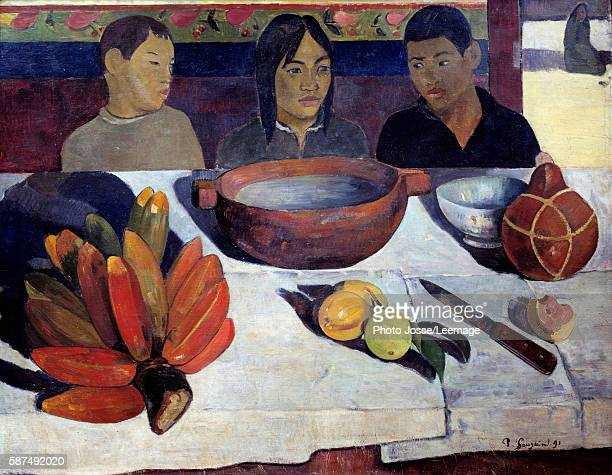 The Meal also called The Bananas. Young Tahitians sitting behind the table. Painting by Paul Gauguin , 1891. Orsay Museum, Paris