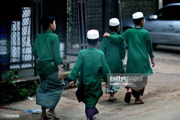 The meaning of Islam is peace and green is widely regarded as the color that symbolizes it. Madrasa students on a break as they head back after the...