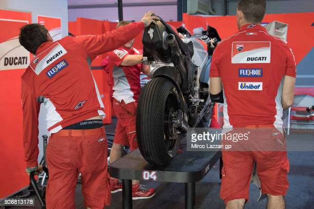 The mechanics at work for cleaning the bike in box after test the wet track during the Moto GP Testing Qatar at Losail Circuit on March 3 2018 in...