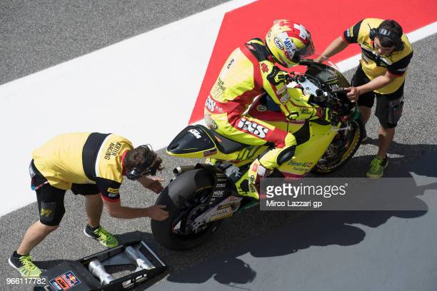 The mechanics of B Dominique Aegerter of Swiss and Kiefer Racing at work on the bike in pit during the qualifying practice during the MotoGp of Italy...