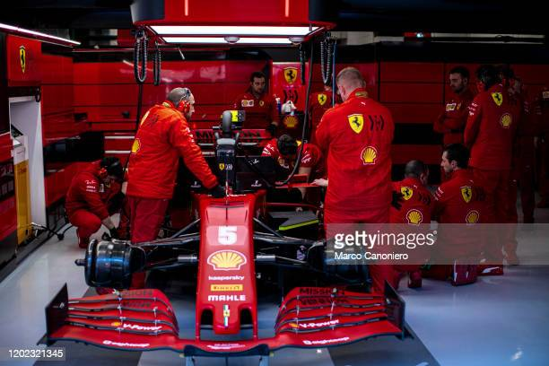 The mechanics of Scuderia Ferrari at work in the garage during day three of F1 Winter Testing.