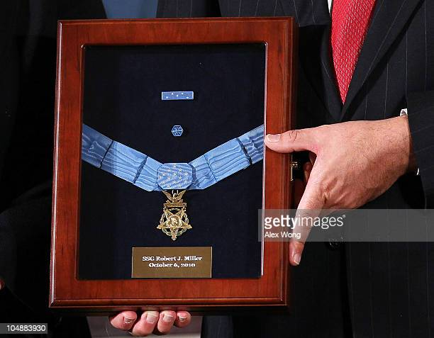 The Medal of Honor is presented to Army Staff Sergeant Robert J Miller during an East Room ceremony October 6 2010 at the White House in Washington...