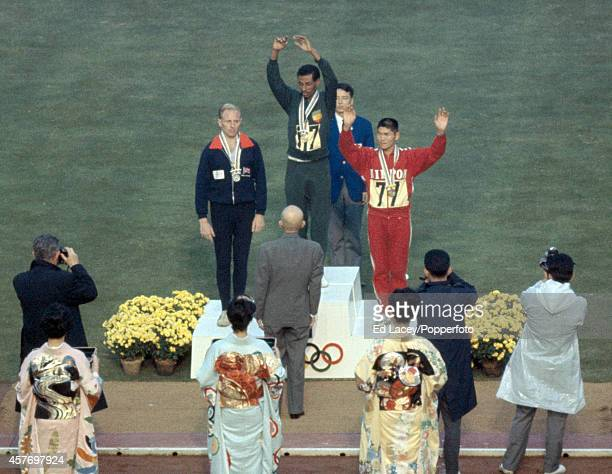 The medal presentation ceremony for the men's marathon featuring, left to right, Basil Heatley of Great Britain , Abebe Bikila of Ethiopia and...