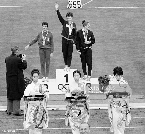 The medal presentation ceremony for the women's 800 metres event featuring left to right Maryvonne Dupureur of France Ann Packer of Great Britain and...