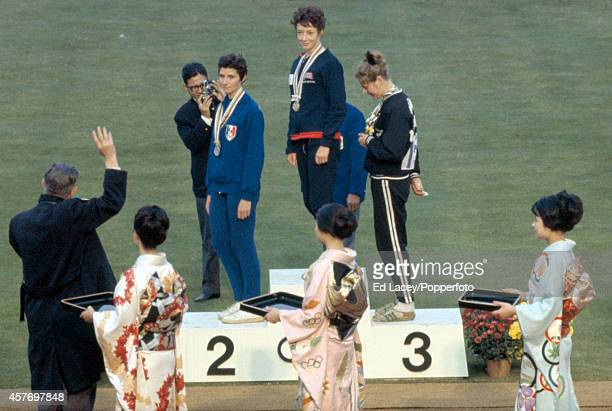 The medal presentation ceremony for the women's 800 metres event with left to right Maryvonne Dupureur of France Ann Packer of Great Britain and...