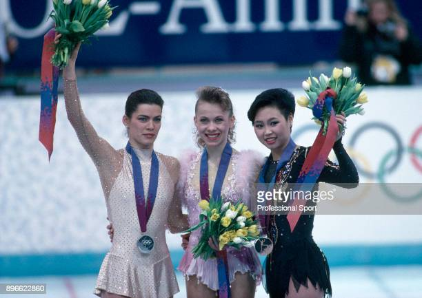 The medal winners in the Women's Figure Skating event Nancy Kerrigan of the USA Oksana Baiul of Ukraine and Chen Lu of China pose together during the...