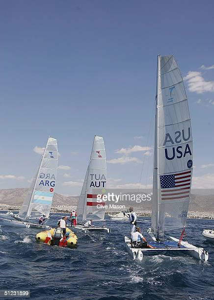 The medalists return to the harbour after the final race in the open multihull tornado finals race on August 28 2004 during the Athens 2004 Summer...