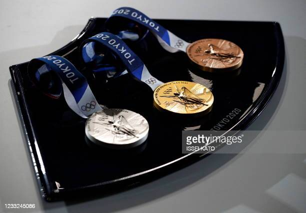 The medals and tray to be used for the medal ceremonies at the Tokyo 2020 Olympics Games are seen during an event to mark 50 days to the opening...