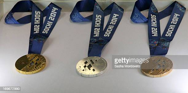 The medals that will be awarded at the 2014 Winter Olympics in Sochi are displayed May 30 2013 in Saint Petersburg Russia International Olympic...