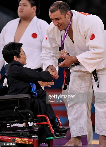 The medals were presented by IPC Governing Board Member Mrs HyangSook Jana in a motorised wheelchair to all the medallists and in this case to Ilham...