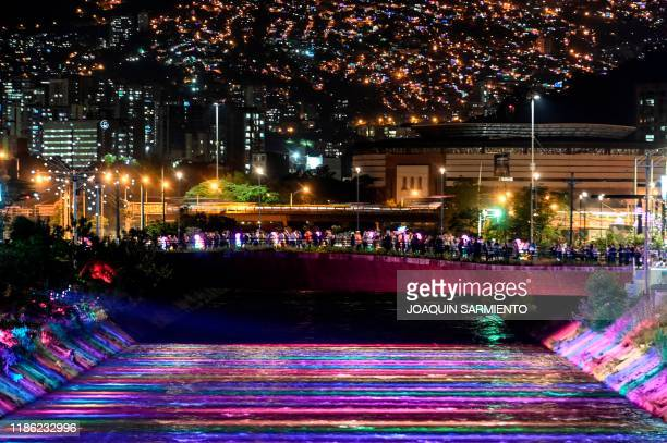The Medellin River and its banks are seen illuminated and decorated for the Christmas season in the Colombian city of Medellin on December 2 2019