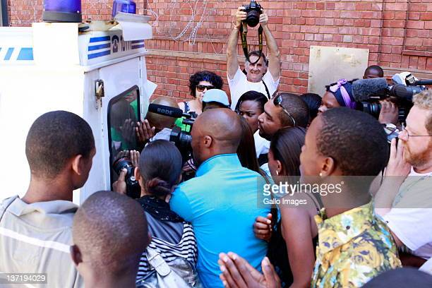 The media and pedestrians mob a police van carrying Dobrosav Gavric a Serbian fugitive seeking refugee status in South Africa after his appearance in...