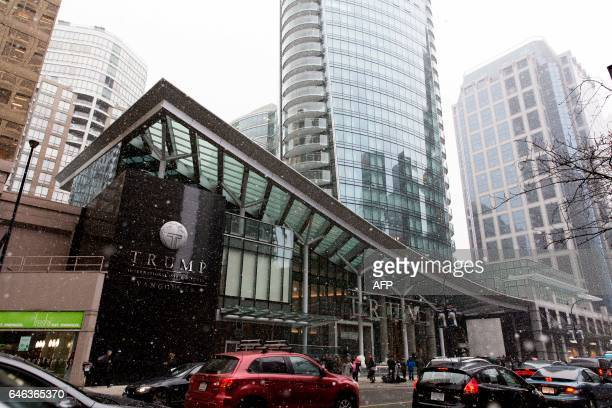 The media and protesters start to gather in front of the Trump Tower in Vancouver before the inauguration ceremeony for the Trump International Hotel...