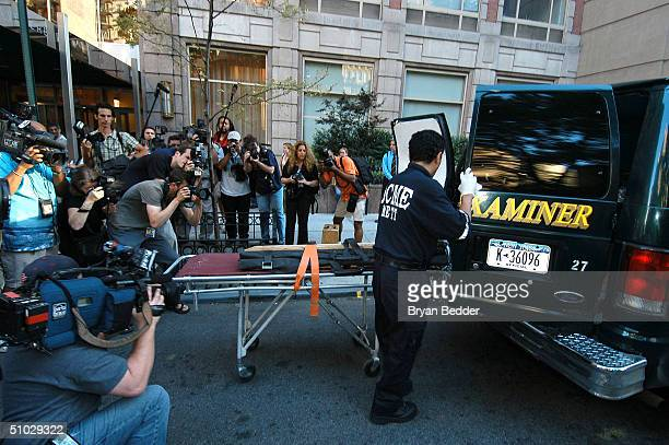 The media covers a medical examiner as he arrives at the building where Eric Douglas the halfbrother of Michael Douglas was found dead July 6 2004 in...