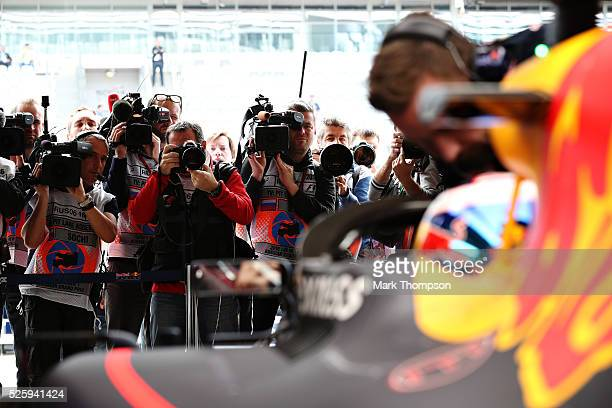 The media crowd around the garage of Daniel Ricciardo of Australia and Red Bull Racing as he prepares to go out in his Red Bull Racing Red BullTAG...