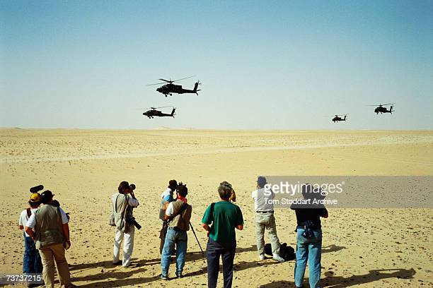 The media film US Apache attack helicopters carrying Hellfire missiles over the Saudi desert before the allied intervention in Kuwait during the...