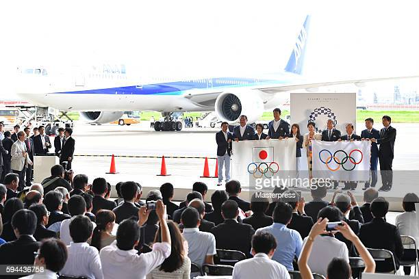 The media gather as the delegates including Rio de Janeiro Olympic Japan squad General Superintendent Yuji Takada SubLeader Yasuhiro Yamashita Leader...