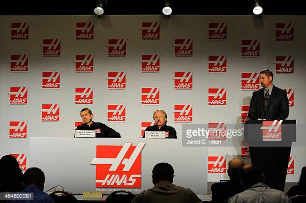 The media looks on as Guenther Steiner, team principal of Haas Formula, Gene Haas, founder, Haas Automation and chairman, Haas Formula, and Mike...