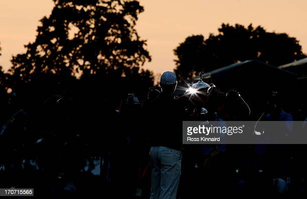 The media photographs Justin Rose of England as he celebrates with the U.S. Open trophy after winning the 113th U.S. Open at Merion Golf Club on June...