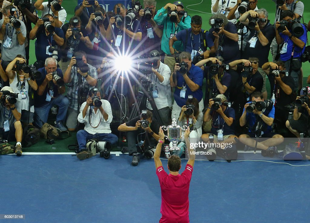 The media photographs Stan Wawrinka of Switzerland celebrating with the trophy after winning 6-7, 6-4, 7-5, 6-3 against Novak Djokovic of Serbia during their Men's Singles Final Match on Day Fourteen of the 2016 US Open at the USTA Billie Jean King National Tennis Center on September 11, 2016 in the Queens borough of New York City.
