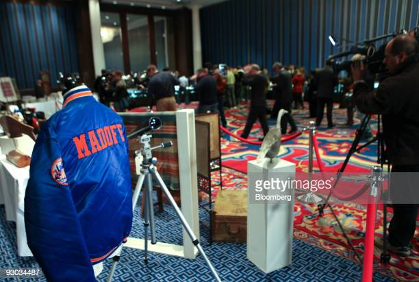 The media report on displayed goods during a media preview for an auction which includes jewelry and other personal items belonging to Bernard Madoff...