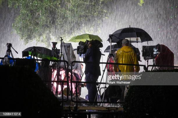 The media stands in the rain shortly before the start of Florida Democratic gubernatorial candidate Andrew Gillum's election night watch party at...