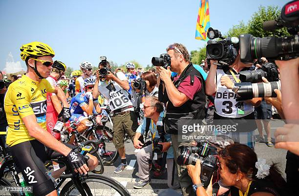The media surround race leader and wearer of the Maillot Jaune Chris Froome of Great Britain and Team SKY Procycling ahead of stage thirteen of the...